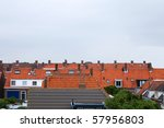 Several Orange Colored Rooftop...