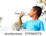 little boy drinking pure water... | Shutterstock . vector #579583573