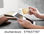woman holding credit card and... | Shutterstock . vector #579657787