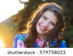 happy young woman walking in a... | Shutterstock . vector #579758023