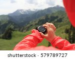 Small photo of Woman hiker checking the altimeter