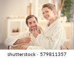 young happy couple drinking... | Shutterstock . vector #579811357