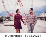 happy couple holding hands and... | Shutterstock . vector #579814297