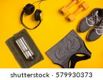 fitness accessories on a yellow ... | Shutterstock . vector #579930373