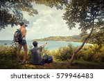 couple tourists with backpacks... | Shutterstock . vector #579946483