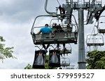 tourist taking a skyride in... | Shutterstock . vector #579959527