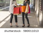 two woman excited with colorful