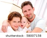 young  happy family in a room... | Shutterstock . vector #58007158