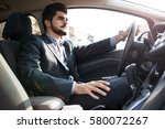 handsome businessman driving a... | Shutterstock . vector #580072267