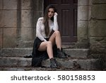 beautiful girl sitting on old... | Shutterstock . vector #580158853