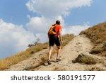 Man Walking Up Steep Mountain