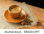 up of coffee on a wooden table.... | Shutterstock . vector #580201597