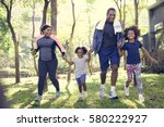 Stock photo exercise activity family outdoors vitality healthy 580222927
