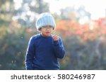 happy boy play the grass flower ... | Shutterstock . vector #580246987