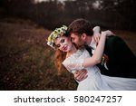 bride and groom on swing on... | Shutterstock . vector #580247257