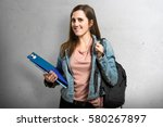 happy teen student girl holding ... | Shutterstock . vector #580267897