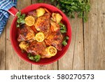 Small photo of Roasted free range organic Chicken skillet dinner with potatoes, carrots, lemon and cilantro.
