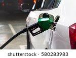 fuel nozzles adding gasoline... | Shutterstock . vector #580283983