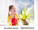 cute girl watering first spring ... | Shutterstock . vector #580305043