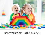 child playing with colorful... | Shutterstock . vector #580305793