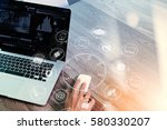 hand using mouse and laptop... | Shutterstock . vector #580330207