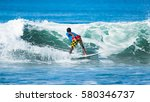 riding the waves. costa rica ... | Shutterstock . vector #580346737