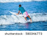 riding the waves. costa rica ... | Shutterstock . vector #580346773