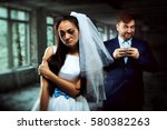 bride with tearful face and... | Shutterstock . vector #580382263