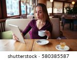 female using wifi on tablet pc... | Shutterstock . vector #580385587