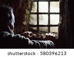 man prisoner watching out from... | Shutterstock . vector #580396213
