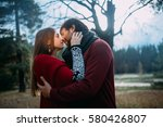 guy and girl in the evening on... | Shutterstock . vector #580426807