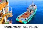 supply boat transfer cargo to... | Shutterstock . vector #580443307