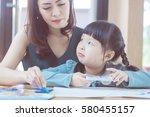 happy beautiful mother teach... | Shutterstock . vector #580455157