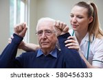 Small photo of Nurse Assessing Stroke Victim By Raising Arms