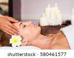 face massage. close up of a... | Shutterstock . vector #580461577