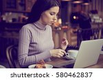 woman working with laptop in... | Shutterstock . vector #580462837
