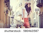 young woman walking with her... | Shutterstock . vector #580463587