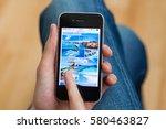 kyiv   february11  hand holding ... | Shutterstock . vector #580463827