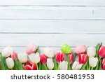 easter eggs and colorful tulips ... | Shutterstock . vector #580481953