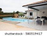 rear garden of a contemporary... | Shutterstock . vector #580519417