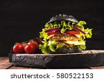 vegan black burger with two... | Shutterstock . vector #580522153