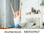 pretty woman stretching herself ... | Shutterstock . vector #580533967