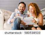 glad couple enjoying freelance... | Shutterstock . vector #580538533