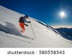 backcountry skier in fresh snow ...   Shutterstock . vector #580558543