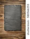 vertical slate black board on... | Shutterstock . vector #580566253