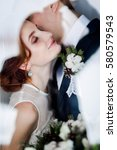 bride and groom kissing in... | Shutterstock . vector #580579543