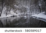 trees covered with snow... | Shutterstock . vector #580589017