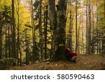 young woman hiking in the... | Shutterstock . vector #580590463
