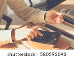 young man using calculator with ... | Shutterstock . vector #580593043