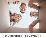 happy family looking through... | Shutterstock . vector #580598347